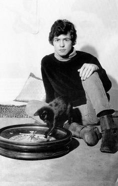 London, England, 15th October 1965, Portrait of 18 year old singer Marc Bolan sitting with Roulette wheel & black kitten. Popperfoto/Getty