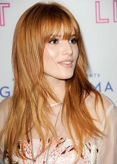 Teen model and actress Bella Thorne looks superb with her sexy, soft layers and long choppy bangs. We adore her warm strawberry blonde hair color, ...
