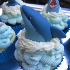 Sink your teeth into these mouthwatering shark-themed cupcakes in honor of Shark Week! Be sure to share with your carnivorous friends by the pool.