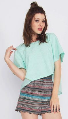 Lily Mint Top*This textured mint top with a high low hem and chiffon back also features an exposed zipper closure details on the back. If you pair this baby with high-wasted bottoms or pattern shorts your outfit will pop with personality. #mint #top