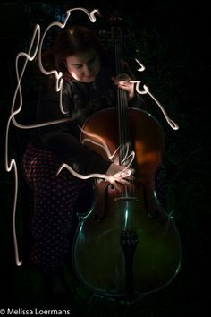 L4M2AS3: Light painting. Used a nurses pen torch to give a broken outline of the cello player. Love how this technique lights up only portions of the musician. Manual mode, outdoors, Nikon D3200, with a tripod and remote shutter release. Bulb mode at 13 sec, F9, 29mm focal length, ISO 200, flash off.