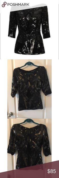 Clothing:: French Connection Spirit Sequin Top French Connection Spirit Sequin Top. Black full sequin top with intricate design. Zipper in back with hook. Only worn twice. Great condition. French Connection Tops Blouses