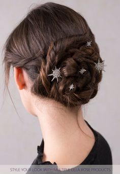 Gorgeous! Twists and braids styled into a bun and bejeweled with sparkling Starburst bobby pins.