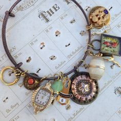 Antique Button Curiosity bangle charms beads and by OldNouveau