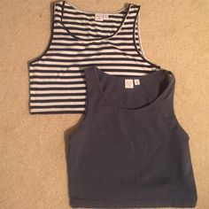 NWOT Bundle of Crop Tank Tops One dark grey and one black and white striped tank top - never ended up wearing these! They aren't super super cropped but they are awesome if you want to wear high waisted bottoms and show a little skin without exposing your entire midriff. bp Tops Crop Tops