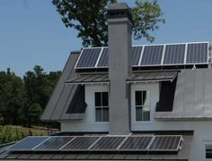 These solar panels are visible on the Bosch Net Zero model home at Serenbe in Chattahoochee Hills, Ga. This house is a local example of Ultra efficient home design, meaning a home that is so energy efficient it can support a family of four for a year with no energy costs.    Photos by Johnny Crawford  Atlanta Journal-Constitution