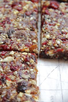 My Happy Place: homemade {3 ingredient} energy bars  1 c. pitted dates 1/2 c. mixed nuts 1/2 c. sunflower seeds 1/2 c. seedless raisins 1/2 c. cranberries 1 1/2 tbsp. organic honey  In a blender, blend all ingredients until a paste has formed. Press the mixture between two pieces of parchment paper in a pan . Refrigerate for at least a few hours or overnight. Cut into squares and wrap with plastic wrap or store in an airtight container.