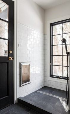 Black and white dog shower in a contemporary mudroom with black slate floor tile. Black and white dog shower in a contemporary mudroom with black slate floor tiles contrasted with w Black Slate Floor Tiles, Black And White Tiles, Slate Flooring, Bathroom Flooring, Tile Floor, Black Bathroom Floor Tiles, Slate Shower Tile, Slate Floor Kitchen, Slate Bathroom