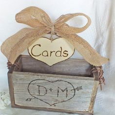 Wedding Card Box With Burlap Bow Grapevine Handle And Personalized Heart Shabby Chic And Rustic Wedding Decor. $59.99, via Etsy.