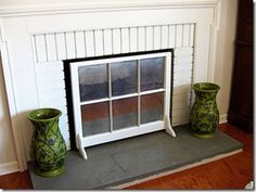 Use an old window as a fireplace screen!