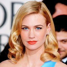 "January Jones. ""Glamorous curls - Mark Townsend, who created this look for Jones, applied a dollop of mousse to wet strands and blew it dry. He side-parted the hair, spritzed it with heat protection spray, and wrapped sections around a medium-sized curling iron. He pinned the curls to the head to let them cool, then brushed through the spirals. 'Use a bristle brush and finish with a lacquer spray for extra shine,' says Townsend."""