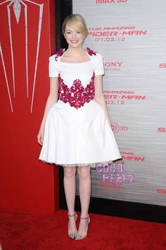 The Amazing Spider-Man world press tour wrapped up in La La Land on Thursday night and Emma Stone did not disappoint.  The 23 year old looked absolutely sensational in a white Chanel Resort with red...
