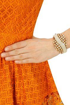 Gold finish pearls and kundan crystal wave bracelet by Rohita and Deepa. Shop at:  http://www.perniaspopupshop.com/designers/rohita-and-deepa #bracelet #rohitaanddeepa #shopnow #perniaspopupshop