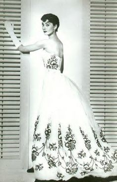 audrey hepburn in a givenchy wedding dress with black lace embellishments...she's so pretty