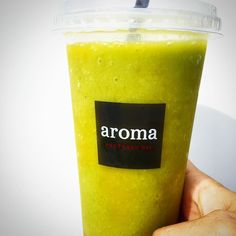 My new favourite way to get fruits and veggies in my belly. @aromaespressobar #mango #kale #smoothie #yum #food #healthyslushies