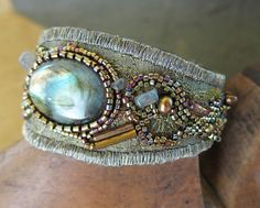 Labradorite Fabric Collage Cuff  Bracelet. $160.00, via Etsy.  This cuff is masterful.  Every stitch has a purpose, mainly to look beautiful!