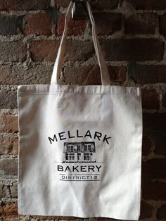 New item- Perfect Christmas gift for Hunger Games fan or Peeta admirer.    Mellark Bakery Cotton Tote Bag by StudioVim