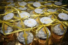 Baptism cupcakes - red velvet cupcakes, yellow and gray fondand cross, indivisualy packed for party favors.