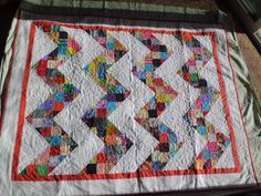 Scrappy chevron pattern quilt by OowiesCreationRoom on Etsy
