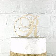 "4 Inch Rustic Wedding Cake Topper Monogram Personalized in Any Letter A B C D E F G H I J K L M N O P Q R S T U V W X Y Z. Our toppers are made from 1/8"" Baltic Birch Wood and have a 2"" tall stake. CakeTopperMonograms also offers custom designs based on artwork you provide. If you have a custom design in mind, send it over and we can work with you to create a topper custom tailored to you! **Have A Smaller or Larger Cake?** We build custom sized toppers all the time. Just let us know what..."