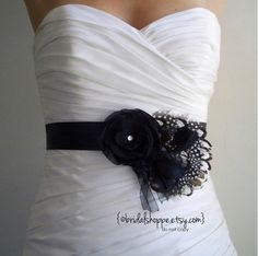 Black Bridal Sash Feathers and Black and White Bridal or Bridesmaids Belt -REESE. $59.00, via Etsy.