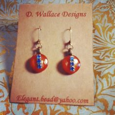 Love these burnt orange antique buttons with blue crystals!!
