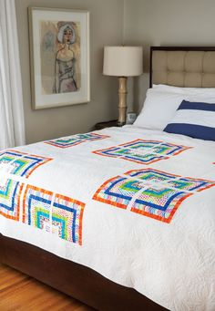 A playful set of prints set against a white background results in an eye-catching quilt. Chain piece the blocks assembly-line style, and you'll be done in no time.