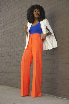 Not giving up finding wide leg pants that would fit perfectly like this one. Loving the loud colour combi with the blazer cape too.