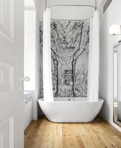 Simple stunning bathroom with ceiling to floor shower curtain, free standing bath tub, wall design and wooden floorboards. Modern, minimal, chic, scandinavian, nordic and beautiful. By: rar.studio