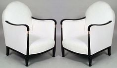 Pair of French Art Deco black lacquered and gilt trimmed bergere arm chairs with