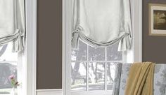 unconstructed roman blinds-- very formal and pretty without being too too