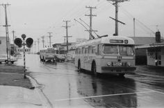 Auckland trolleybuses crossing the Onehunga rail line Kiwiana, October 10, Auckland, Buses, Graham, New Zealand, Distance, Trains, 1970s