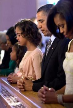 The First Family. Praying together, and staying together. Love it!