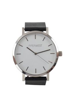With it's clean look and silver / white / black colour story this beautifully crafted time piece features a polished silver stainless steel case white face with minimalist silver markers and an interchangeable black saffiano genuine leather band... pssst this is the same leather they use on Prada bags!!!!! Each PIPERWEST time piece is customized with logo lettering on dial and at buckle closure. Classic Minimalist Watch by PIPERWEST. Accessories - Jewelry - Watches Alberta Canada