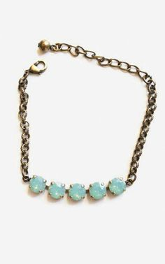Vintage brass setting with Swarovski turquoise crystals. Layer with your watch and other bracelets for a bit of color.