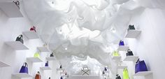 for the italian luxury leather company's 80th anniversary, a pop up made of billowing white and muted textiles envelops the retail space.