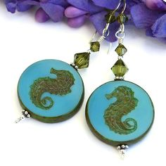 I almost wanted to hoard these Czech glass sea horse beads because the mermaid in me loves them so much. But after much thought, I decided they needed to be created into a beautiful pair of earrings instead.