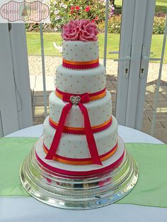 Colourful Summer Wedding Cake with pink sugar roses, by Queen of Cakes