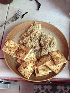 New favorite red container! Pan fried tofu and quinoa.