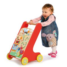 A brightly coloured wooden activity walker with a selection of manipulative toys on the front.