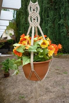 Macramé plant hanger made with durable polyolefin macrame cord. The color is called Pearl (beige color). Has dark brown wood beads. It can hold a 10 diameter planter. It is approximately long from top of ring to bottom of fringe. Macrame Plant Hanger Patterns, Macrame Plant Holder, Macrame Patterns, Plant Holders, Cordon Macramé, Macrame Owl, Macrame Knots, Micro Macramé, Macrame Design