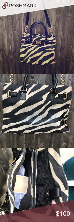 """Zebra print Michael Kors roomy purse There are so many places to store things in the stylish bag! Unfortunately, as shown in the pic, my jeans transferred a bit of color on the back side. The gold buckle detail and chain and leather strap combo really make this bag pop! Comes with the dust bag as well! Measurements: 11""""x12"""", and the shoulder strap measures: 15"""". Michael Kors Bags Shoulder Bags"""