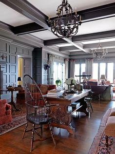 Coffered ceilings in elegant grays with rich woods give this living room a sophisticated air. An antique game table provides a quiet place for reading and relaxing. - Traditional Home®  Photo: Jonny Valiant and Joseph St. Pierre Design: Nancy Gould