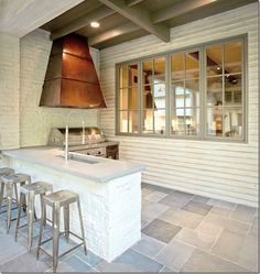 fabulous outdoor kitchen- A mUST do if you have the space and pretty easy, cinderblocks/stucco or other or painted too? love the grilll area too...