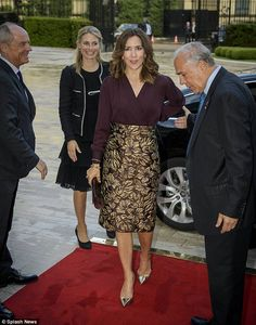 On another occasion, Princess Mary was also seen sporting a maroon top paired with a skirt...