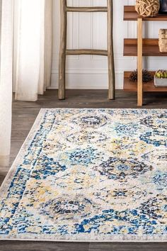 A patchwork of traditional Persian rug motifs looks fresh and modern in shades of blue. Navy, light blue, aqua, robin's egg, and beige create a foundational palette that will blend well with bohemian, modern, coastal, or even traditional decor. Power loomed from the softest polypropylene available, it's also durable and easy to clean. #JonathanY #HomeDeco #AreaRugs #InteriorDesign Modern Coastal, Light Installation, Rug Cleaning, Home Rugs, Traditional Decor, Power Loom, Persian Rug, Trellis, Colorful Rugs