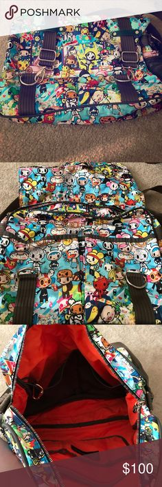 TOKIDOKI 2009 messenger bag TOKIDOKI 2009 messenger bag; used but in good condition. A few pen marks on the interior pocket; no rips or tears. Super spacious bag with lots of compartments. tokidoki Bags Crossbody Bags