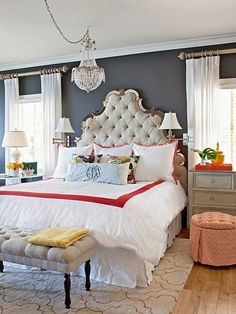 Love this masterbedroom, the dark walls, light curtains, patterned rug and pretty pillows. The chandelier above the bed is so fun too!