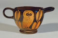 An ancient Greek skyphos decorated with an owl between two olive twigs, all symbols of the goddess Athena, and of Athens. (Kunsthistorisches Museum Vienna)