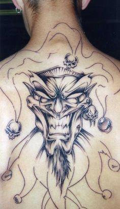 Grey Ink Jester Tattoo On Man Back Body